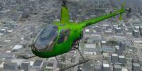 TACSA Robinson R22 in flight.