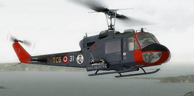 Turkish Navy Bell UH-1C in flight.