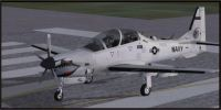USN Low Vis Embraer A-29B Super Tucano on runway.