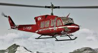 VIH Cougar Helicopters Bell 212 in flight.