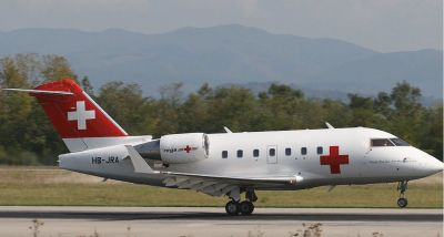 Photograph of Bombardier Challenger 604 on runway.