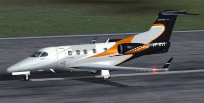 Embraer Phenom 300 PP-XVJ on runway.