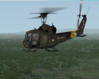 Royal Netherlands Navy Bell UH-1C in flight.