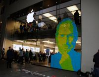 Steve Jobs memorial created from post-it notes on the front of an Apple store.