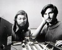 Steve Jobs and Steve Wozniak working together.