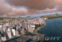 Pre-Release screenshot of Microsoft Flight demonstrating buildings, water and clouds.