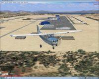 Screenshot of plane flying past Eleftherios Venizelos Airport.