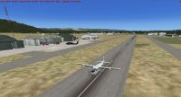 Screenshot of a plane on a runway at Kalispell City Airport.