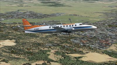 Screenshot of a plane flying over Maturin International Airport Scenery.