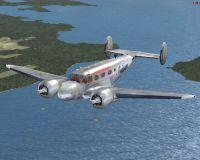 Screenshot of Beech C45H Expeditor Cargo Plane in flight.