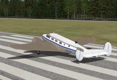 Screenshot of Beechcraft D18S on runway.