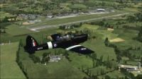Screenshot of plane flying over Duxford Airfield Scenery.