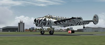 "Screenshot of ""Flying Safaris"" Beechcraft D18S/SNB on runway."