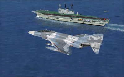 Screenshot of fighter jet flying past carrier.