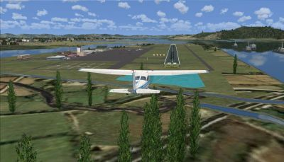 Screenshot of plane approaching runway at Kohnan Airport.