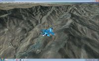 Screenshot of plane flying over mountains.
