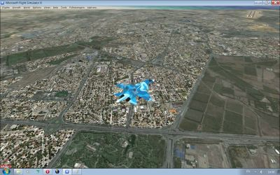Screenshot of plane flying over towns.