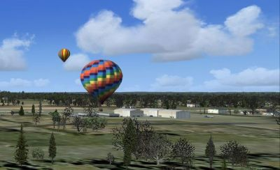 Screenshot of balloons over Philadelphia scenery.