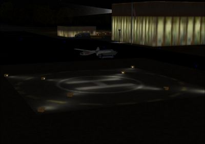 Screenshot of helipad and terminal at night.