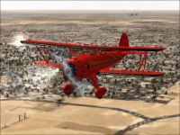 Screenshot of a red Waco Classic in flight.