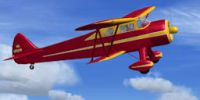 Screenshot of Waco SRE Aristocrat in flight.
