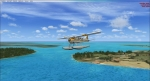 De Havilland Beaver about 300 ft over the Caribbean Islands