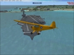 Civil Air Patrol Piper J3 Cub flyng over Aircraft Carrier in the Pacific