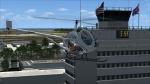 300CBI Hover alongside Aloha Tower at PHNL