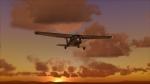 Cessna 182 over a dusky sky.