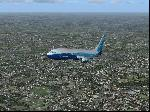 Boeing 737 flying East out of London