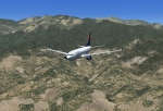 Delta Boeing 737-700  descending over the mountains