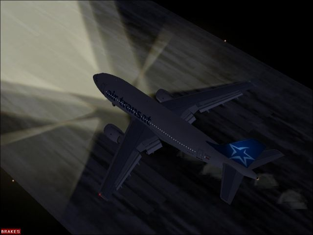 Air Transat landing at night