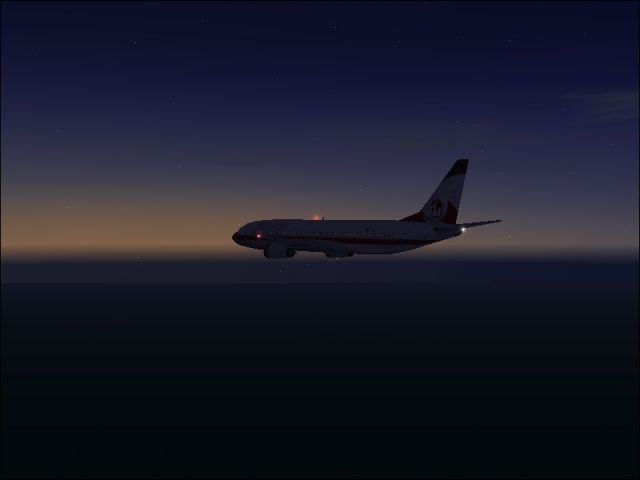 Flying over the Atlantic Ocean with a nice sunset