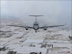 Flying over snow in winter