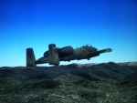 A-10 Warthog flying over mountains