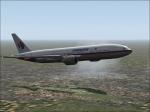 Malaysia B777-300 in flight