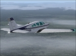 Bonanza F33A flying over clouds