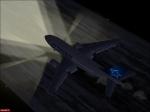 Air Transat landing at night