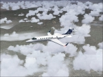 LearJet 45 Flying Over Clouds