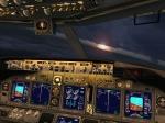 Dawn in cockpit over Miami