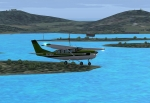 Cessna 208 Stationair over lakes