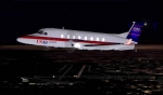 Beech 1900 passes Dupage Airport