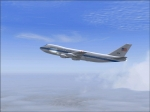 The E-4B high over clouds