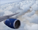 ba plane over someclouds