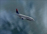 Delta 737-200 flying over a lake
