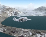 Cessna Caravan over Alaskan lake