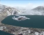 Cessna Caravan over Alaskan lake
