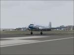 DC-3 centerd on the runway