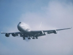 Air New Zealand Boeing 747 Emerging from Clouds