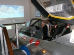 trying aelectric lightning fighter simulator at Tangmrre military aviation museum